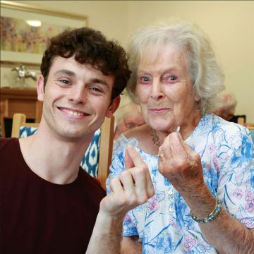 SIXPENCE IN HAND. Wellington Grange resident Halcyon McLaren with lead actor Charlie Stemp.