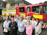 Staff at Braemar Lodge with firefighters and trainers following the fire drill