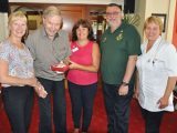 Avon Reach resident Derek Harker presents the new oximeter to Mike Jukes, Group Co-ordinator, Bransgore Community First Responders watched by (left to right) Linda Brownlie, Operations Manager; Ruth Wildman, Home Manager, and Gabriele Solescu, Clinical Lead.