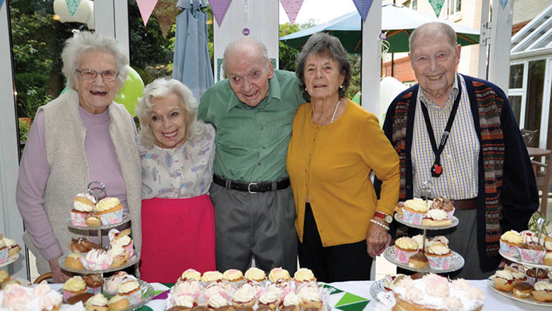 LET US EAT CAKE:  Residents (from left) Audrey Loader, Mouchka Belle, Sam Tydesley, Sybil Woodward and John Ledger survey the wonderful confections at Amberwood House.