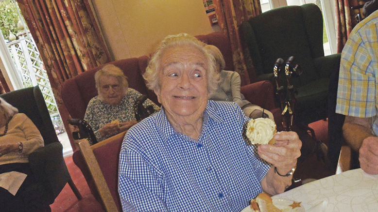 I'VE WON:  Braemar Lodge resident Dora Williams, 91, with her golden cupcake.