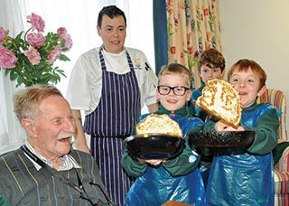 Cubs from Sturminster Newton Scout Group join residents and staff at Newstone House for a pancake party.
