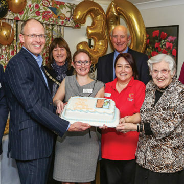 Party guests included Colten Care joint founder John Colwell (fourth right); Ian Hudson, Executive Chairman (left); Mark Aitchison, Chief Executive (second left); Cllr Anne Corbridge, Mayor of Lymington and Pennington (third left) and Katie Whiteside, Home Manager (fourth left).