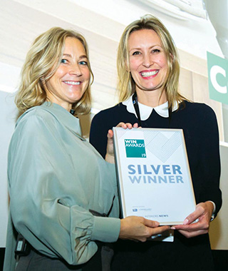 Head of Design Georgina Colwell, above right, receives the Silver Winner's certificate at the WIN Awards from architect and ITV presenter Helen Sisley.