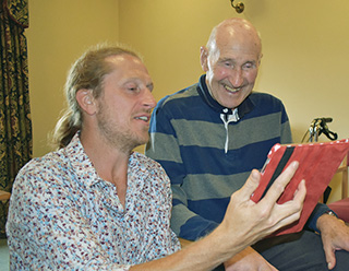 GAME ON : Malcolm Burgin shares a joke with Ken Cobb, aged 86, while playing on an iPad