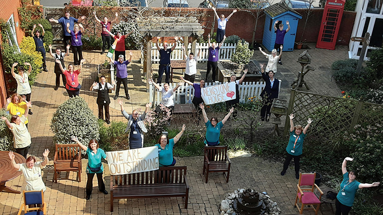 Magnificent seven WE ARE OUTSTANDING:Team members at Newstone House celebrate the CQC's inspection report while observing social distancing.... read article...