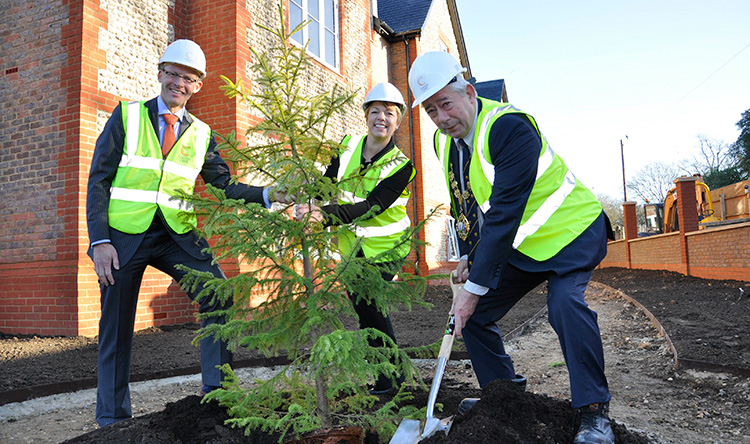 PUTTING DOWN ROOTS: The Mayor of Chichester, Councillor Peter Budge, planted the first tree at Wellington Grange watched by our Chief Executive Mark Aitchison and Home Manager Clare Gibson.