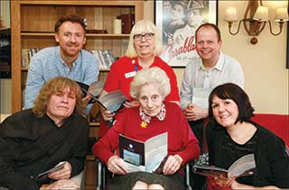 POETS CORNER: At Linden House are (left to right) Colten Care Marketing Director Tim Wookey, storyteller Chris Bennett, Colten Companion Chris Dimmick, resident Frances Evans, St Barbe Director Mark Tomlinson and project lead Laura Bullivant.