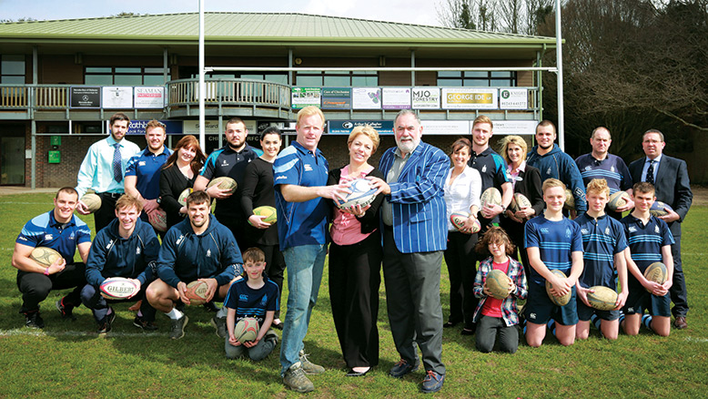 WELL MATCHED: The Wellington Grange team, including Clare Gibson, Home Manager, with Chichester Rugby Club officials and players;