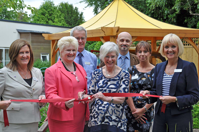At the opening of The Aldbury dementia garden (Karen is on the far right, holding the ribbon).