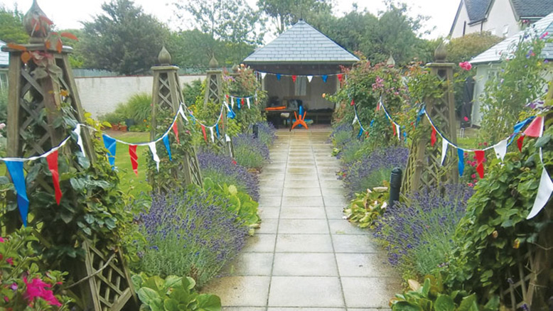 The Belmore Lodge gardens are a riot of colour, whatever the weather a British summer can throw at it!