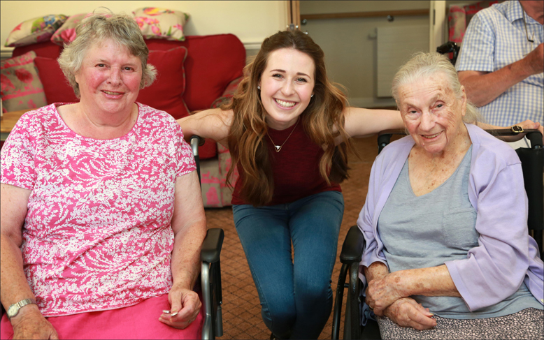 SMILES. Devon-Elise Johnson, who plays Ann Pornick in Half A Sixpence, with Wellington Grange residents Brigetta Reynolds, left, and Bunny Storrer.