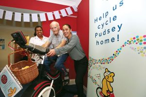 Court Lodge residents and staff take turns on the exercise bike