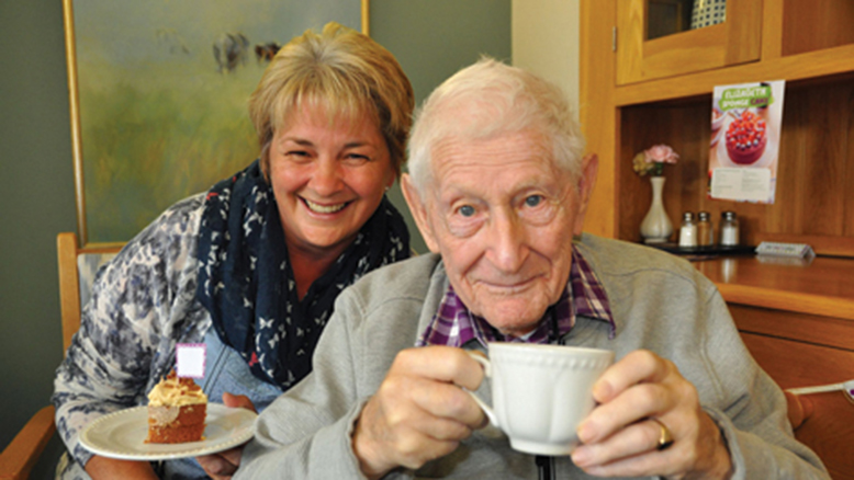 FAMILY FEAST:  Court Lodge resident Frank Sayers toasts the coffee morning with daughter Nicky.