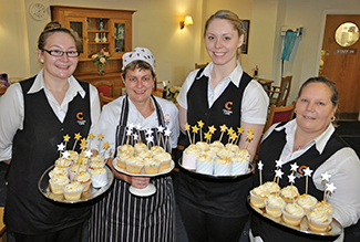 SPARKLING SUCCESS: Holding the Willy Wonka-style cupcakes at Braemar Lodge are Chef Frankie Collingwood, second left, with Waitresses, from left, Sam Painter, Hollie Millerchip and Lorraine Bedford.