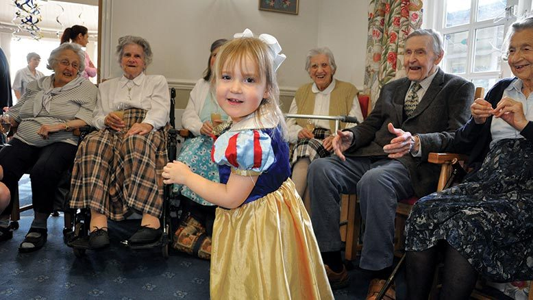 It's a hat-trick! SNOW WHITE SMILES. Little Woodpeckers visitor Stephanie Tyrrell entertains residents, including Elspeth Shepherd, seated far left, with a dance at the home's CQC celebration party.  ... read article...