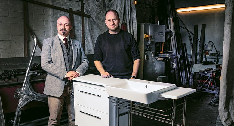 Alan Portsmouth, our Head of Technical Design (far left), with Julian Bailey of Fusion Fabrication and one of the bespoke vanity units specially made for Bourne View.
