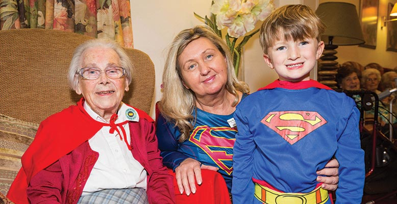 Kingfishers' Home Manager Beata Brzozowska and residents met a fellow superhuman at themed afternoon of fun with Durlston Court Prep School
