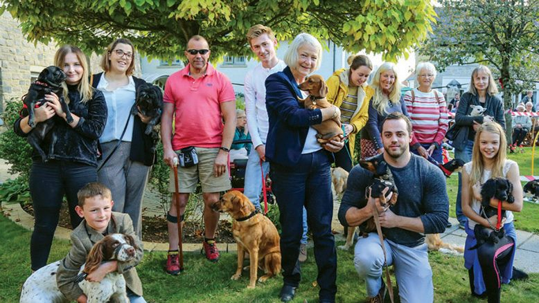 Kate Adie: journalist to judge BBC news reporter Kate Adie (centre, holding dachshund) with some of the entries for the charity dog show held at Castle View, Poundbury, in aid of Hearing Dogs for the Deaf... read article...