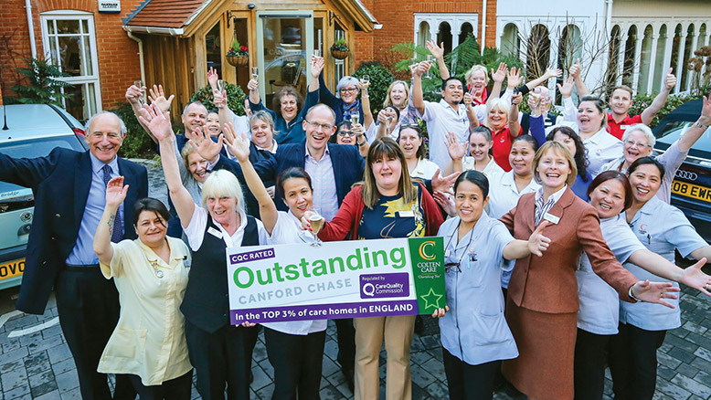 OUTSTANDING TEAM: Charlotte Wilson, Home Manager, (front centre); Colten Care co-founder John Cowell (left); Mark Aitchison, Chief Executive (second row, behind Charlotte) and Elaine Farrer, Operations Director (front row, third from right) join Canford Chase staff to celebrate the home's CQC 'Outstanding' rating.