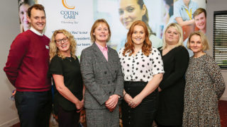 TEAM SPIRIT: Elaine Farrer, Operations Director (third from left), with Senior Companionship Team Leaders, from left: Ben Benson-Breen, Donia O'Connor, Emily Hudson and Ellie Peter. On far the right is Fiona Prichard, our Music & Arts Partner.