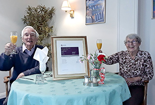 TOP RATED: Kingfishers residents John Hall and Valerie Collinge raise a glass to celebrate the home retaining its Outstanding rating.