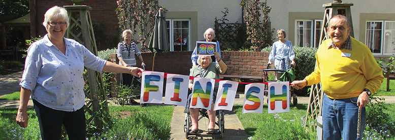 FINISH: Residents and team members at Braemar Lodge in Salisbury finish their walk in aid of the 2.6 Challenge.