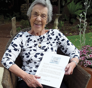 Resident Jean Nichols with the letter of reply from Dame Vera