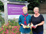 Scout Group Leader Lisa Massey and son Barnaby Pearce bring the pebbles to St Catherines View