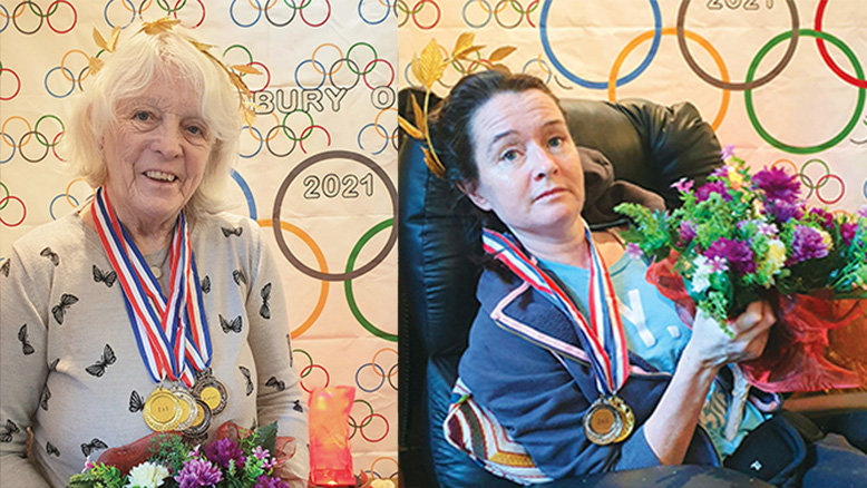 Beryl Spalding and Pip Smith with medals and flowers