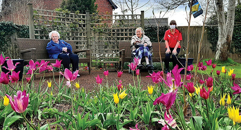 Seated in the garden at Woodpeckers are, from left, residents Elspeth Shepard and Betty Hampton, and Companionship Team Member Rose Applin.