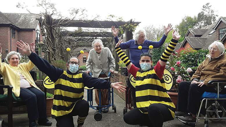 Court Lodge Companionship team members Cat Loubser and Julia Puia, dressed as bees, with residents, from left: Mary Wharmby, Maureen Jones, Rose Joyce and Ann Melrose, 99, who started the residents off on 99 laps of the garden.