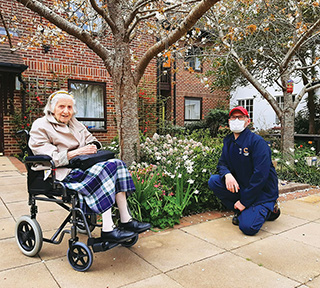 In the garden at Woodpeckers are resident Betty Hampton and gardener Chris Marsh.
