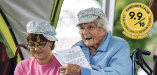 Wearing a sequined cap, 105-year-old Braemar Lodge resident Iris Stowell takes part in our Abba singalong at Salisbury's Victoria Park.