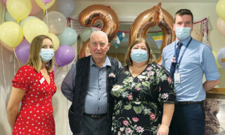 Celebrating 20 years of Abbotts Barton are, from left, Companionship Team Leader Kirsty Sawyer, resident John Arbor, Home Manager Dee Lovewell and Operations Manager Peter Doyle.