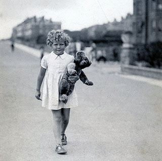 Rosalind Ransome walking with Teddy Edward in the 1930s.